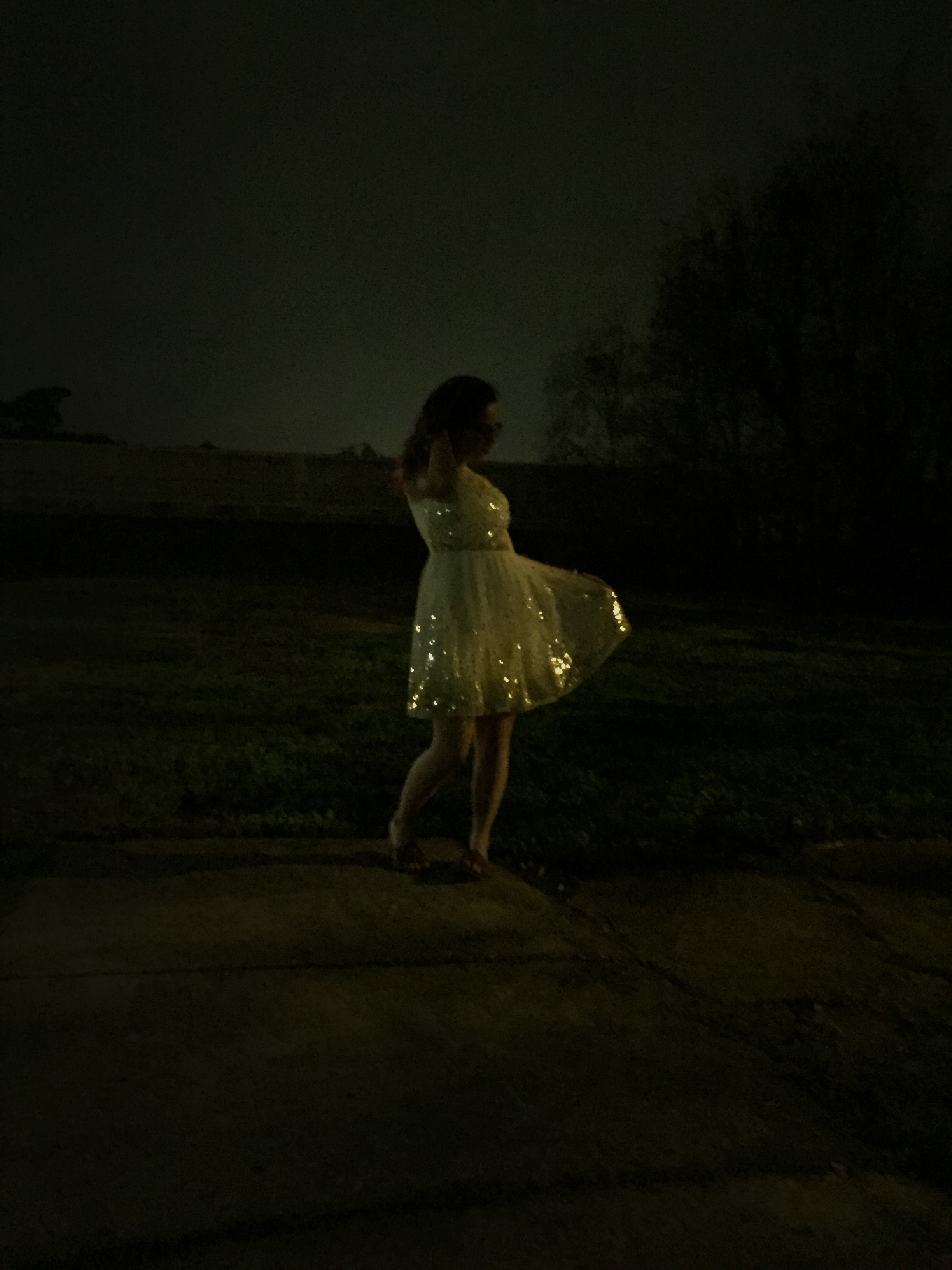woman in sparkly dress at night
