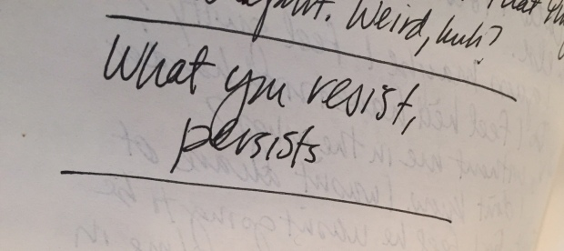 "image of journal with words ""what you resist, persists"