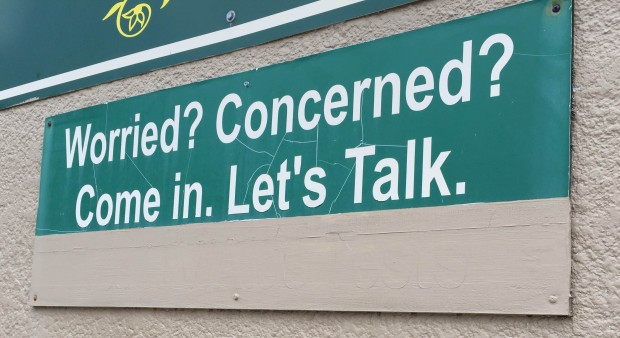 """photo of sign that says """"worried? concerned?"""""""
