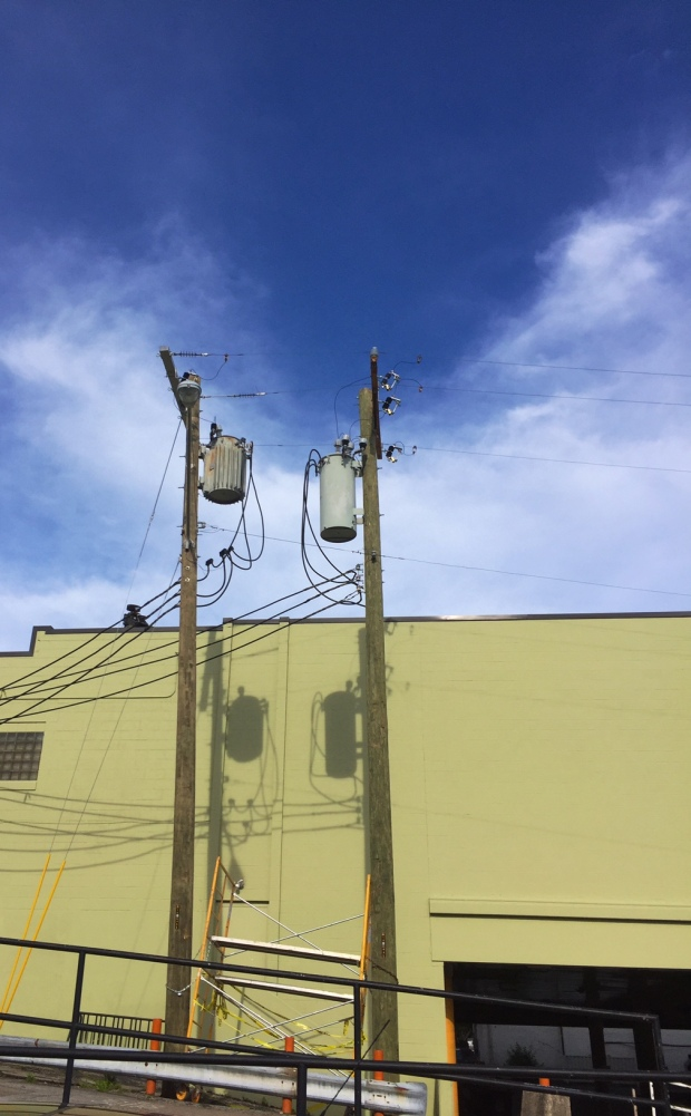 two electrical poles side by side