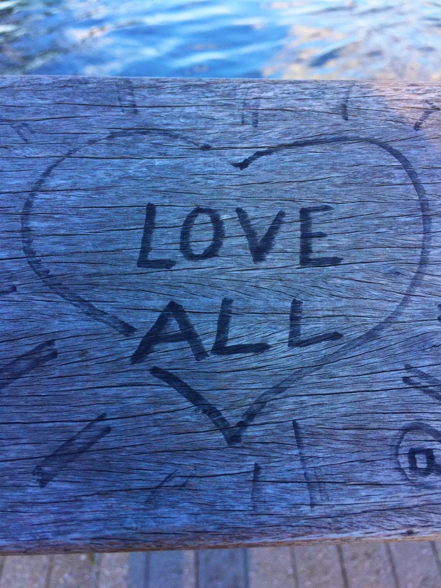"picture of graffiti that says ""love all"""