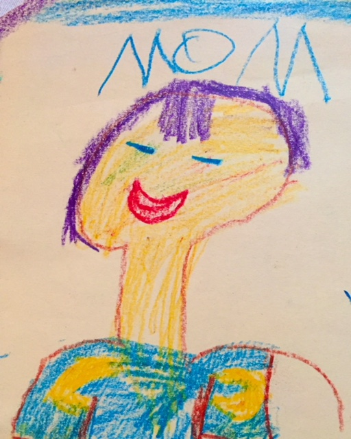 """crayon drawing of a smiling purple-haired woman, with """"MOM"""" written above it."""